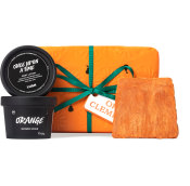orange gift with green ribbon with products around it