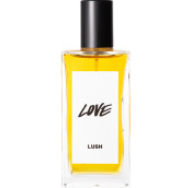 A bottle of Love Lush perfume. The perfume is golden yellow in colour and contained in a rectangle bottle featuring a black lid and white label.