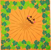 Oranges Lokta Papier bedruckt mit einem geschnitzten Kürbisgesicht
