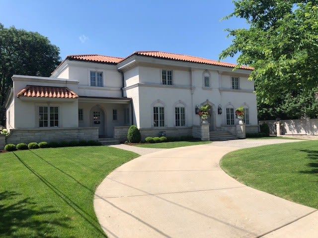 Stately all stucco and stone exterior set on a premier Southeast Hinsdale location