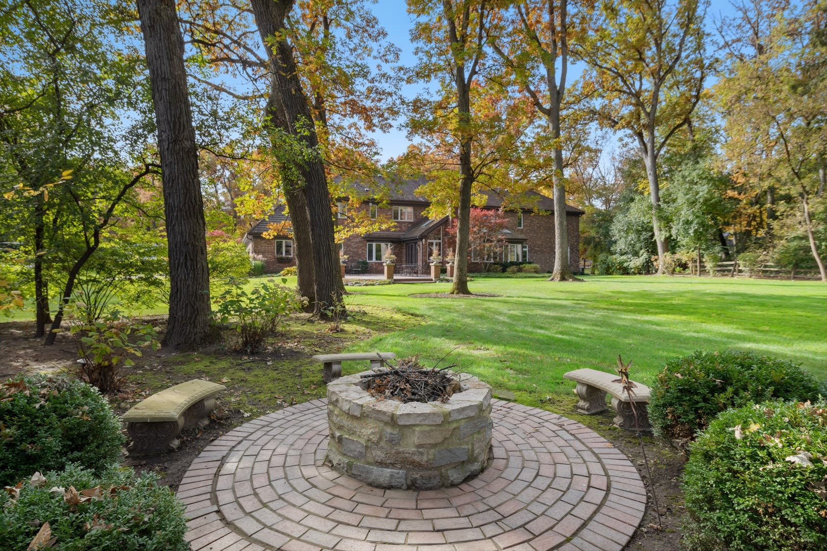 Beautifully Appointed Home in a Gated Community on Over an Acre of Professionally Landscaped Grounds with Pond Views