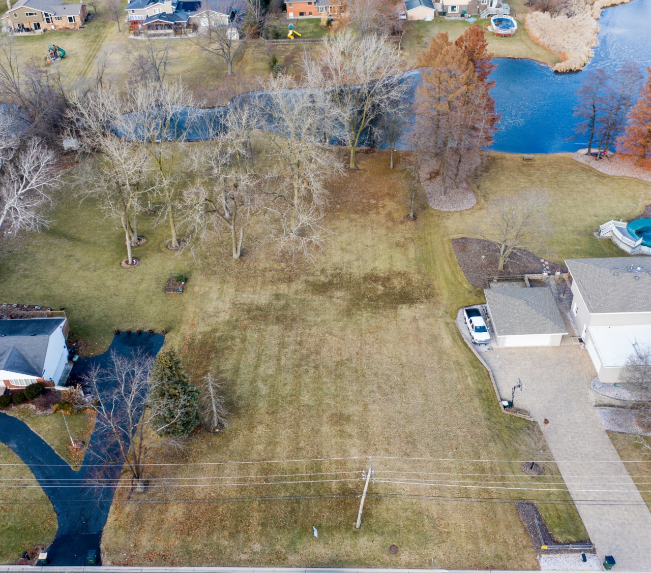 beautifully positioned land on a .84-acre lot, offers impressive views of a 5-acre spring-fed pond