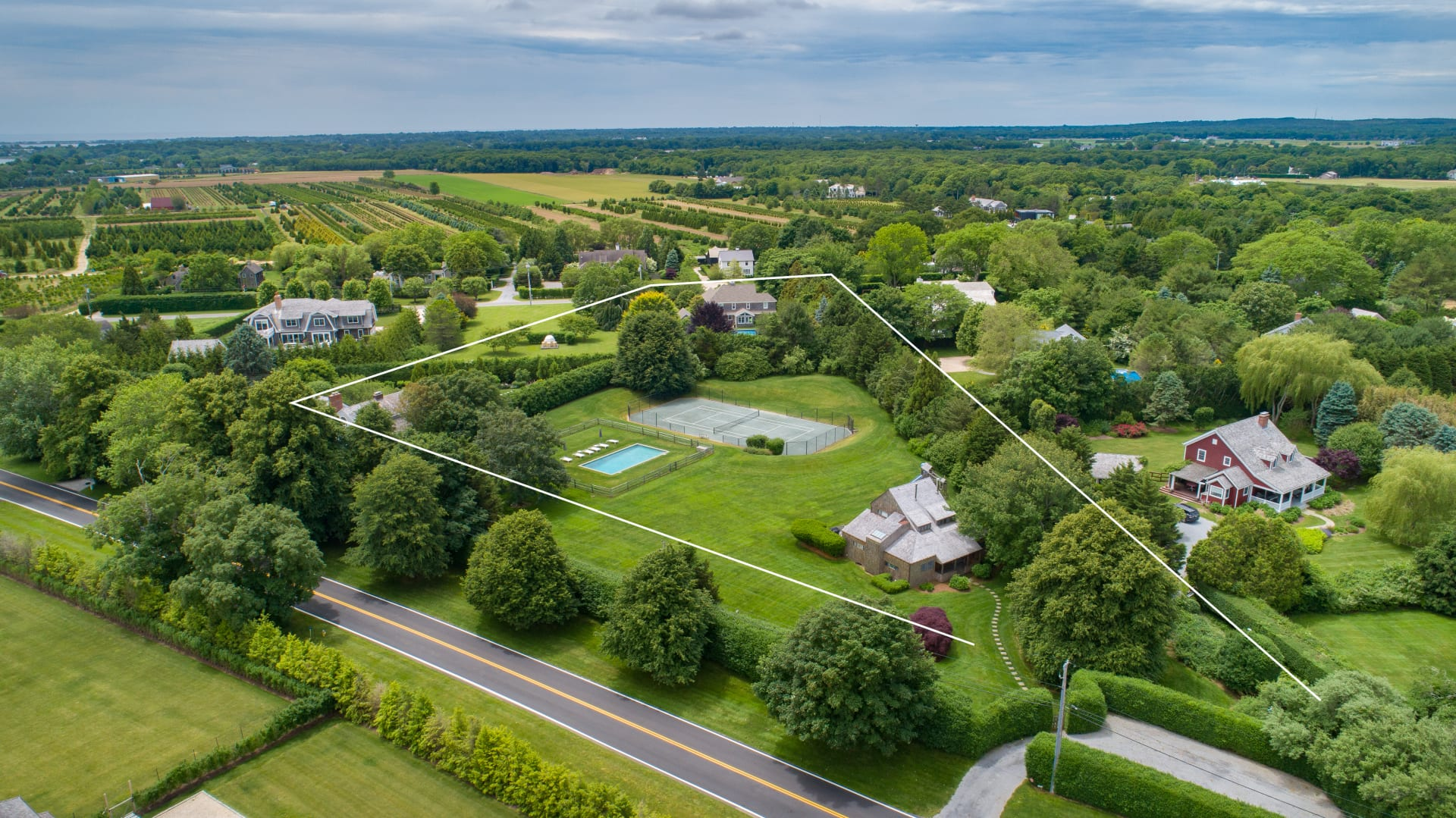 Stunning Water Mill Property with Sprawling Grounds and Massive Potential
