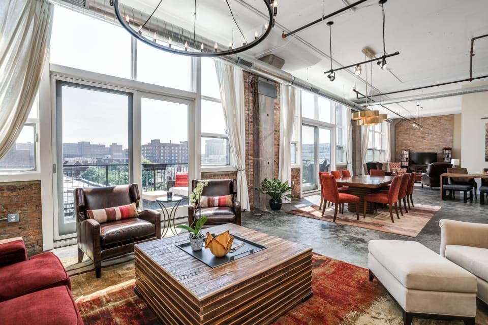 $1M Detroit condo has 55-foot wall of windows, glass doors, balconies