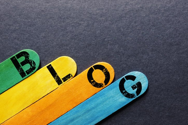 sticks with different colors showing the letters to spell Blog