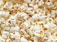 Air-popped popcorn with no added oil or butter is a lower calorie filler food.