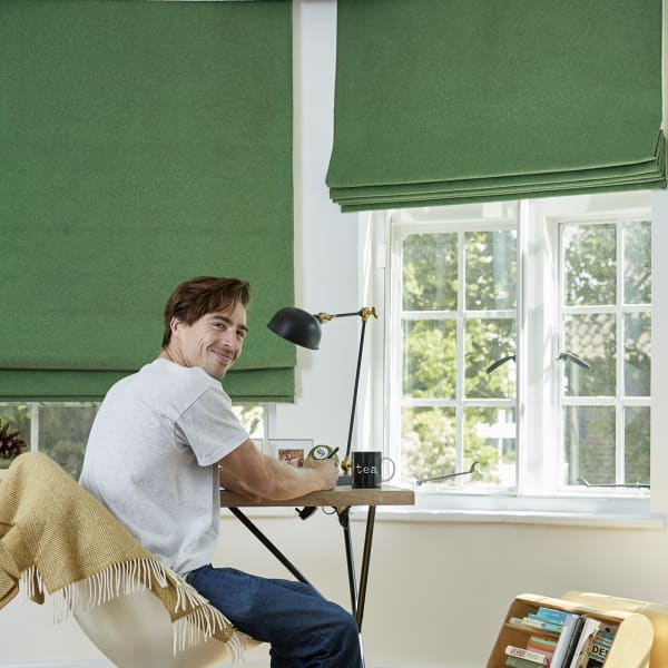 customer portrait infront of green slik curtains