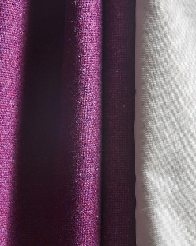 close up of purple curtain stitching