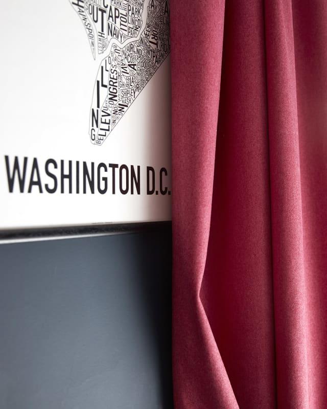 Pink Wool curtain against dark wall