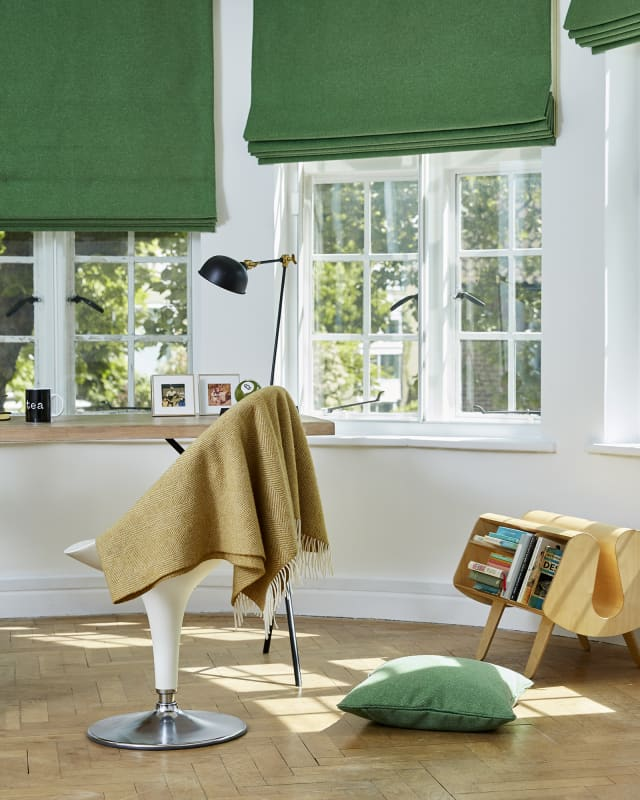 green slik curtains in study