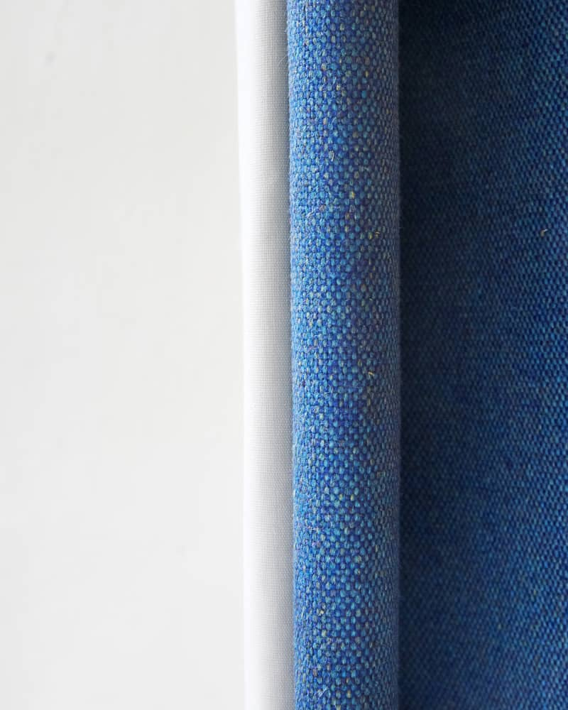 close up of blue curtain stitching