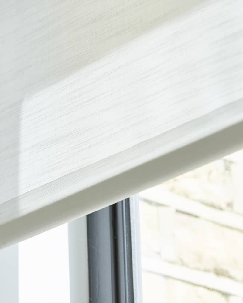 Textured white roller blinds close up