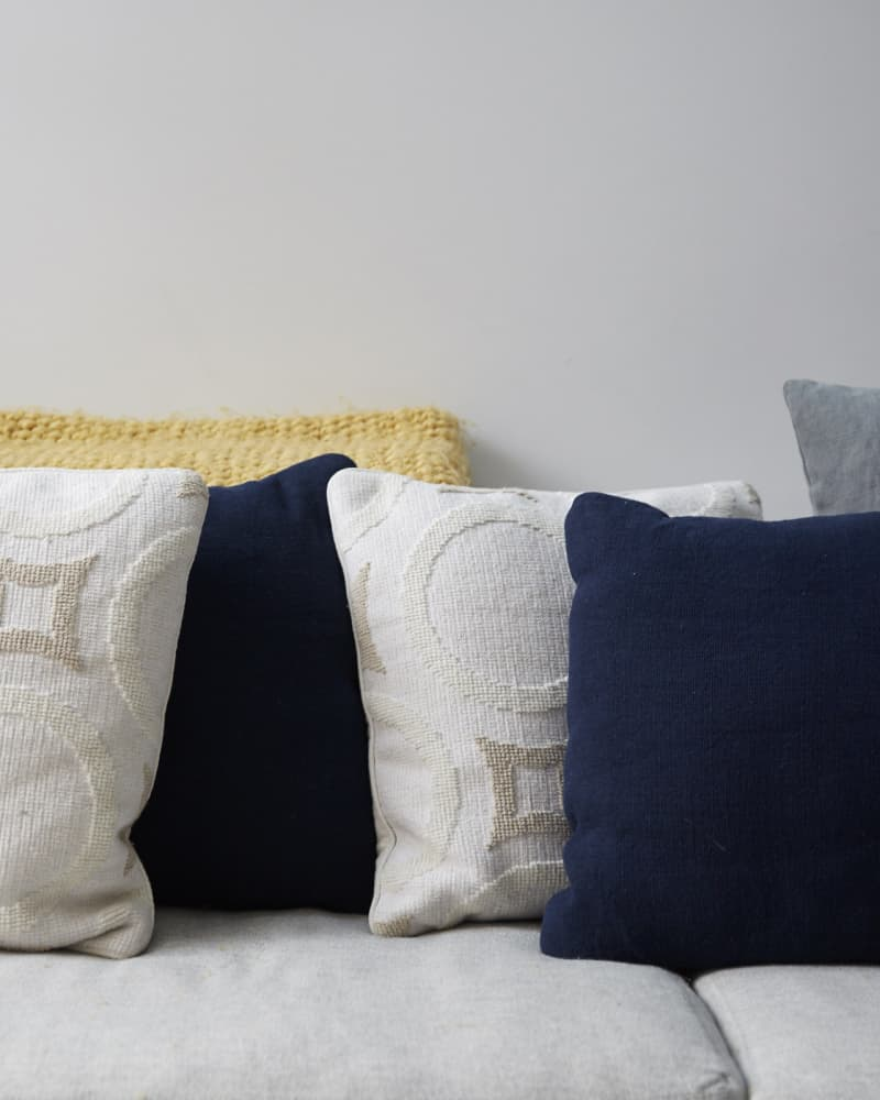 White grey and navy cushions