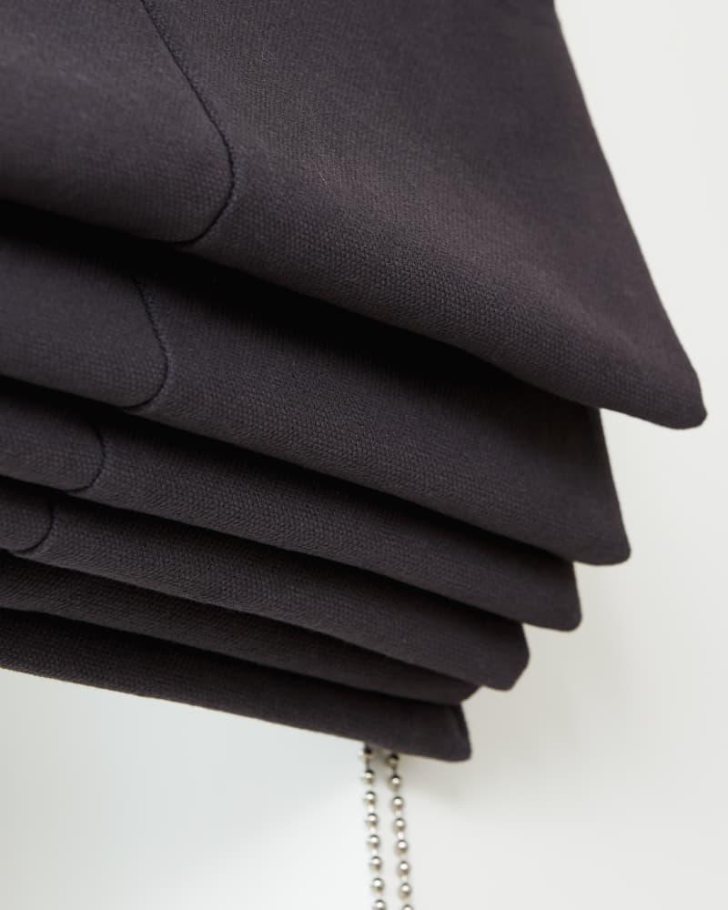 close up of black roman blinds