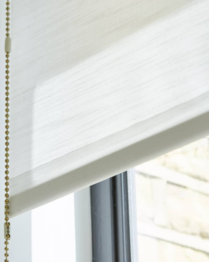 close up of white roller blinds