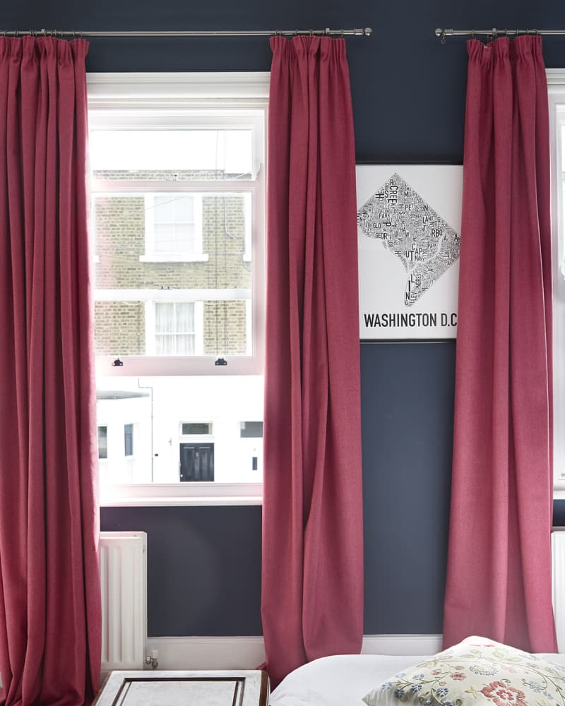 pink pencil pleat curtains on the wall
