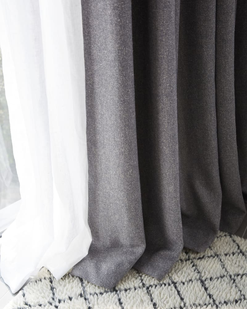 close up of grey curtains and white linen curtains