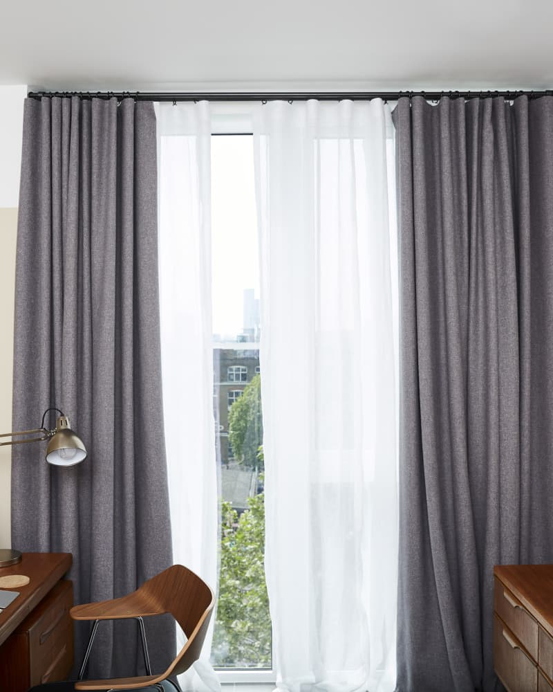 Grey curtains in wave style