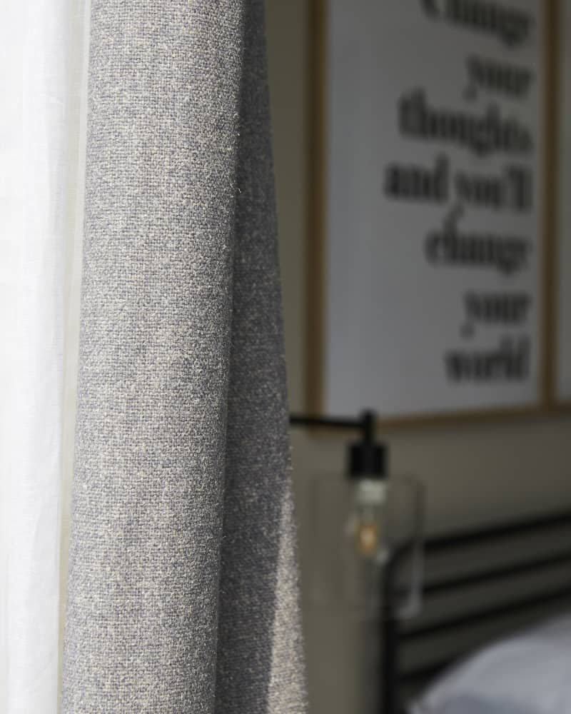 close up of grey curtain stitching