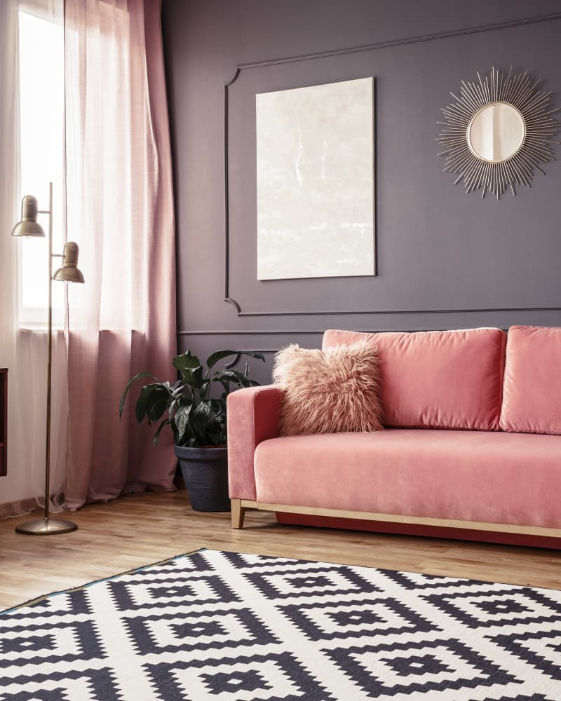 living room with grey walls and baby pink features