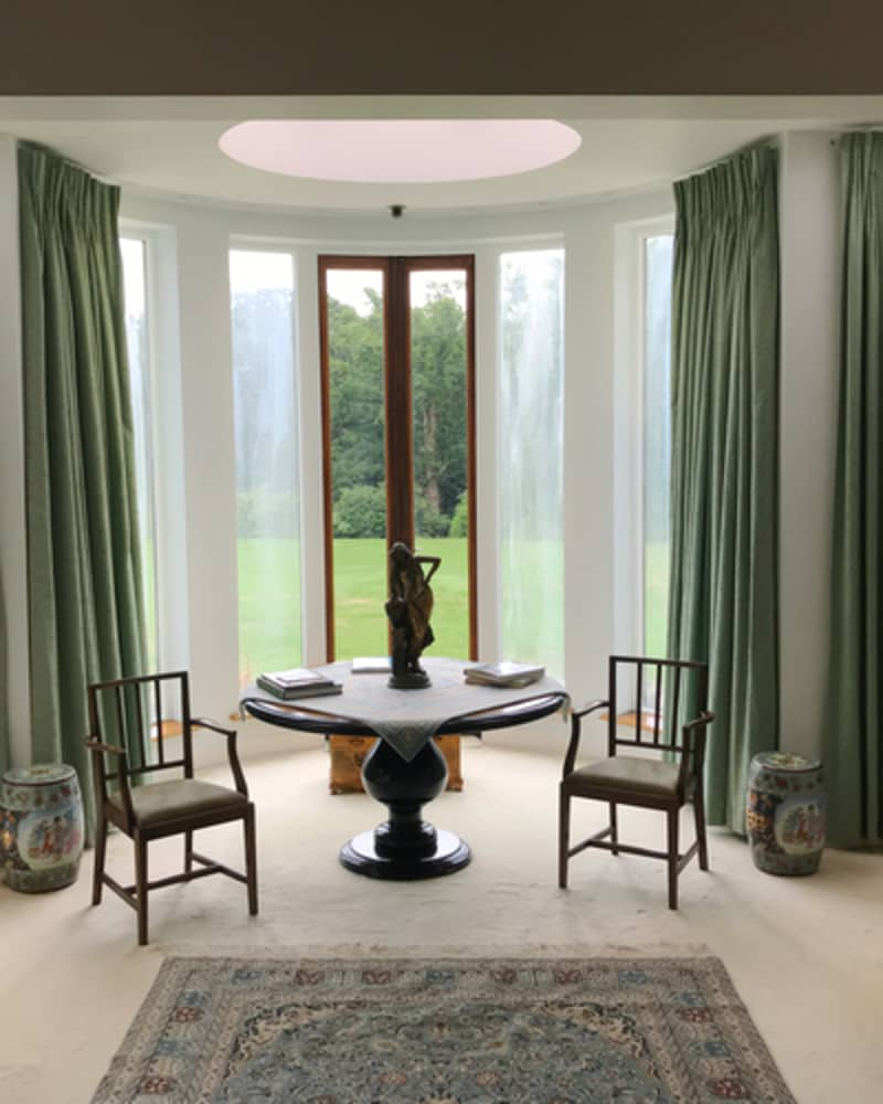 dining room with olive green curtains