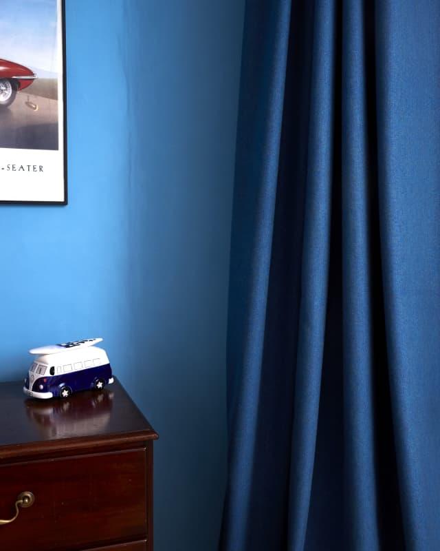 blue curtain against blue wall