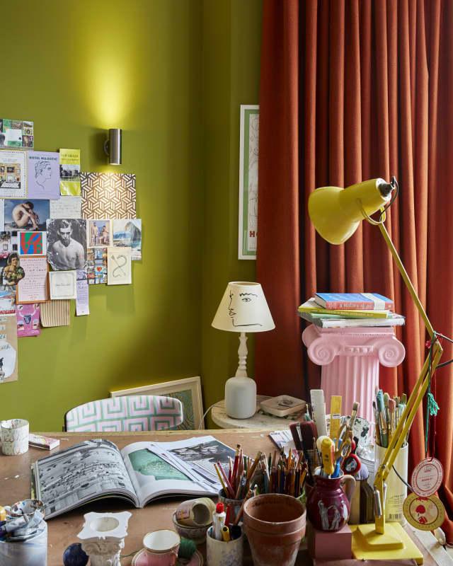 orange curtain behind art desk