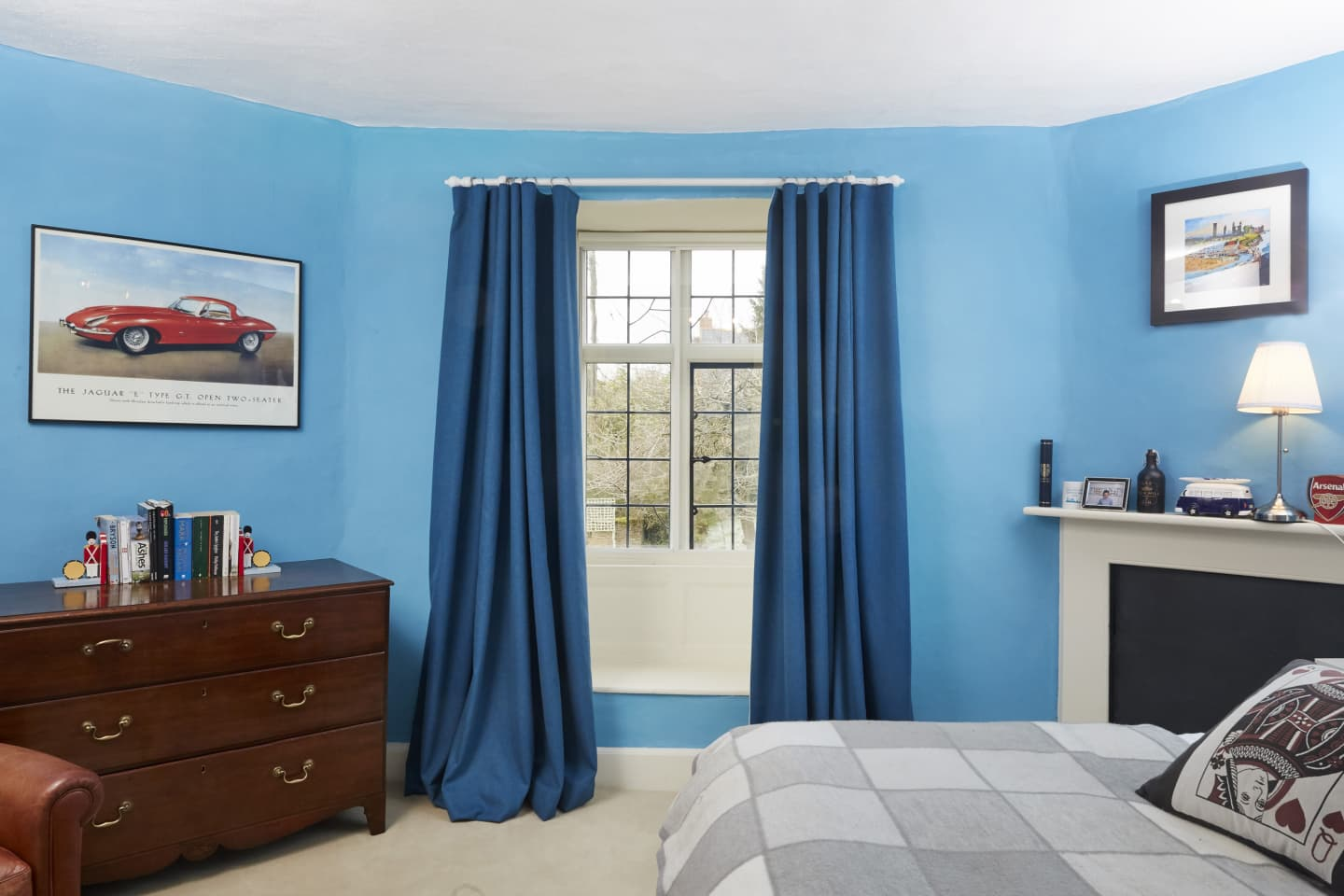 Blue bedroom with Dark navy blue curtains
