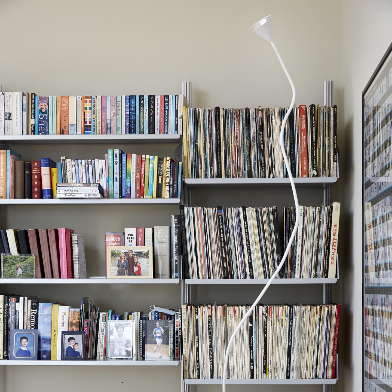 Shelves full of books and vinyl records