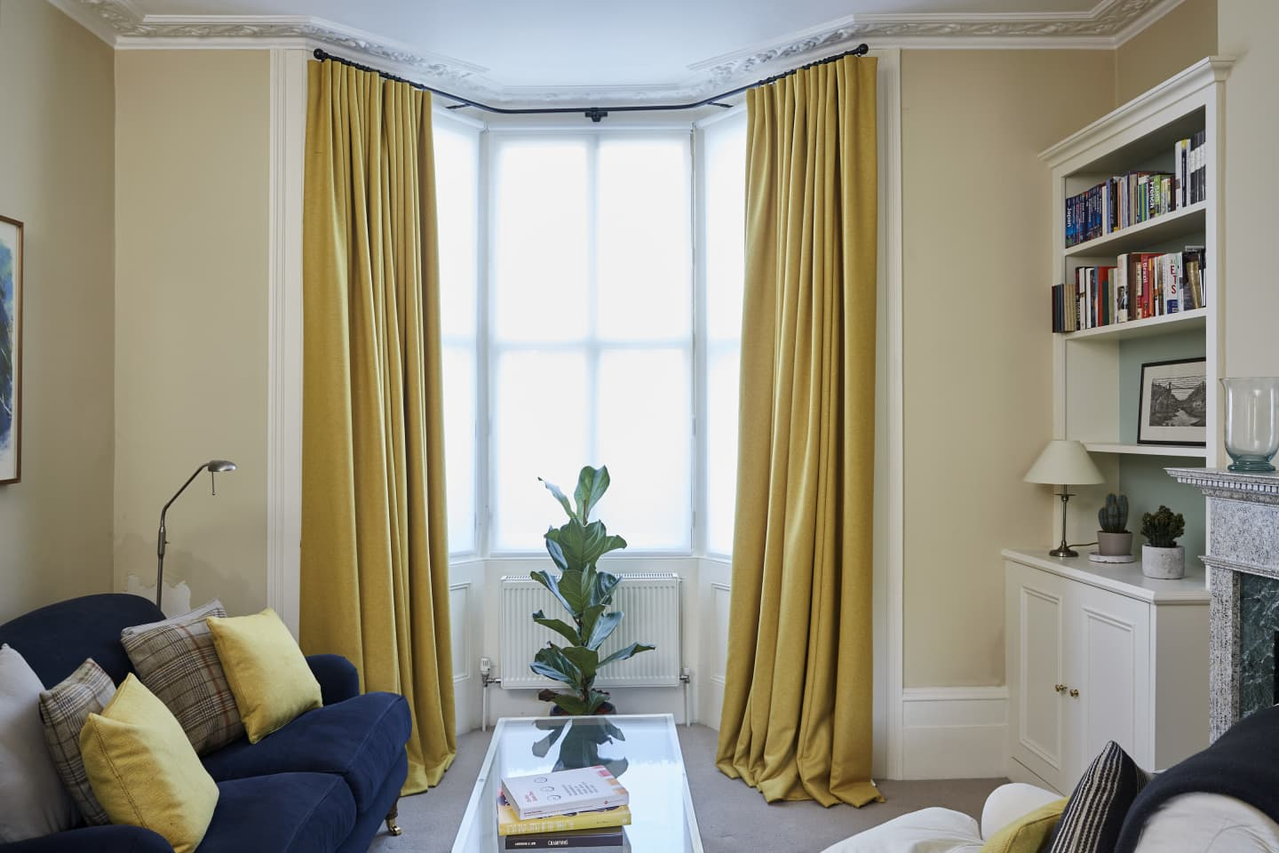 Yellow drawn silk curtains in a living room