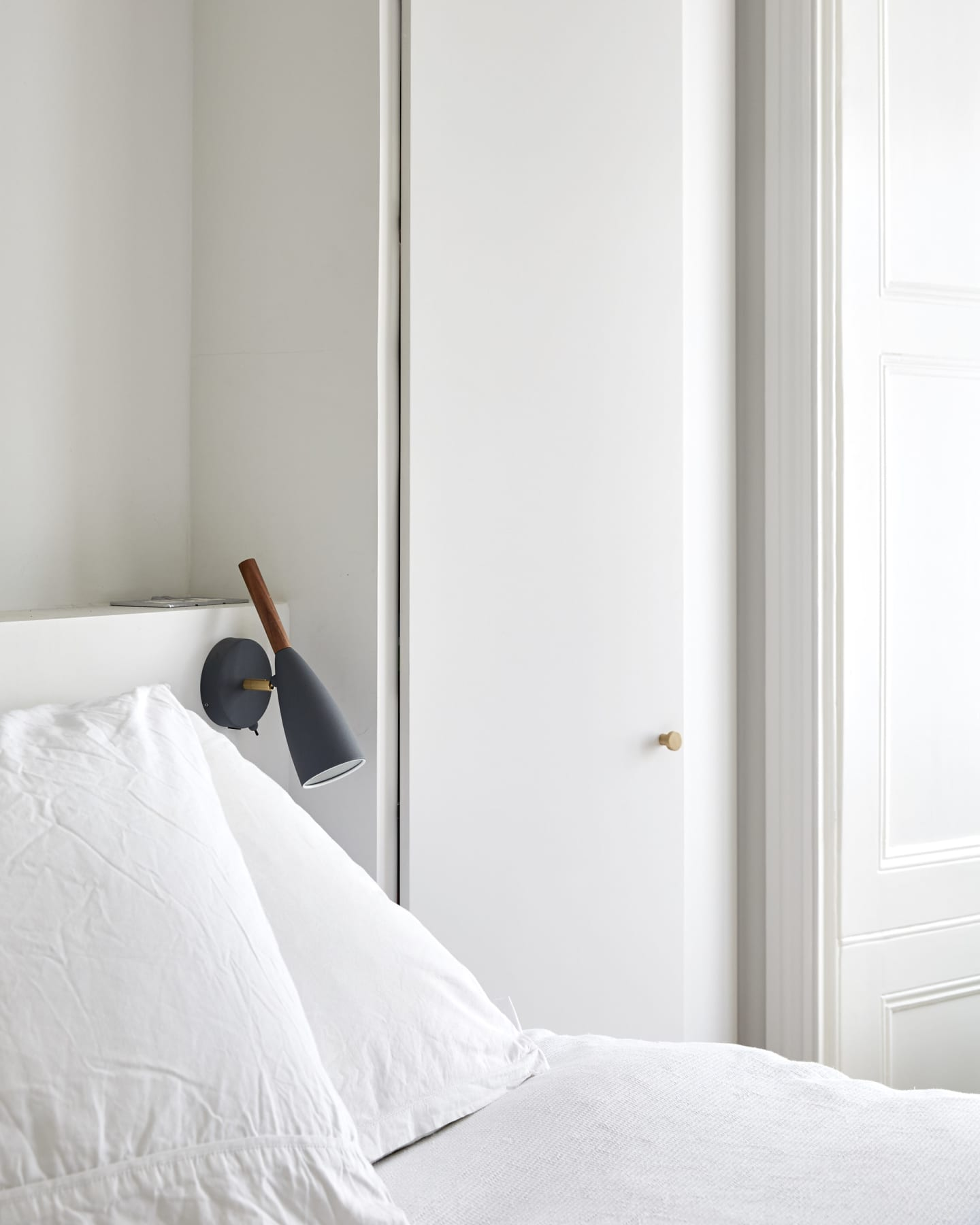 Natural light shining into a white bedroom