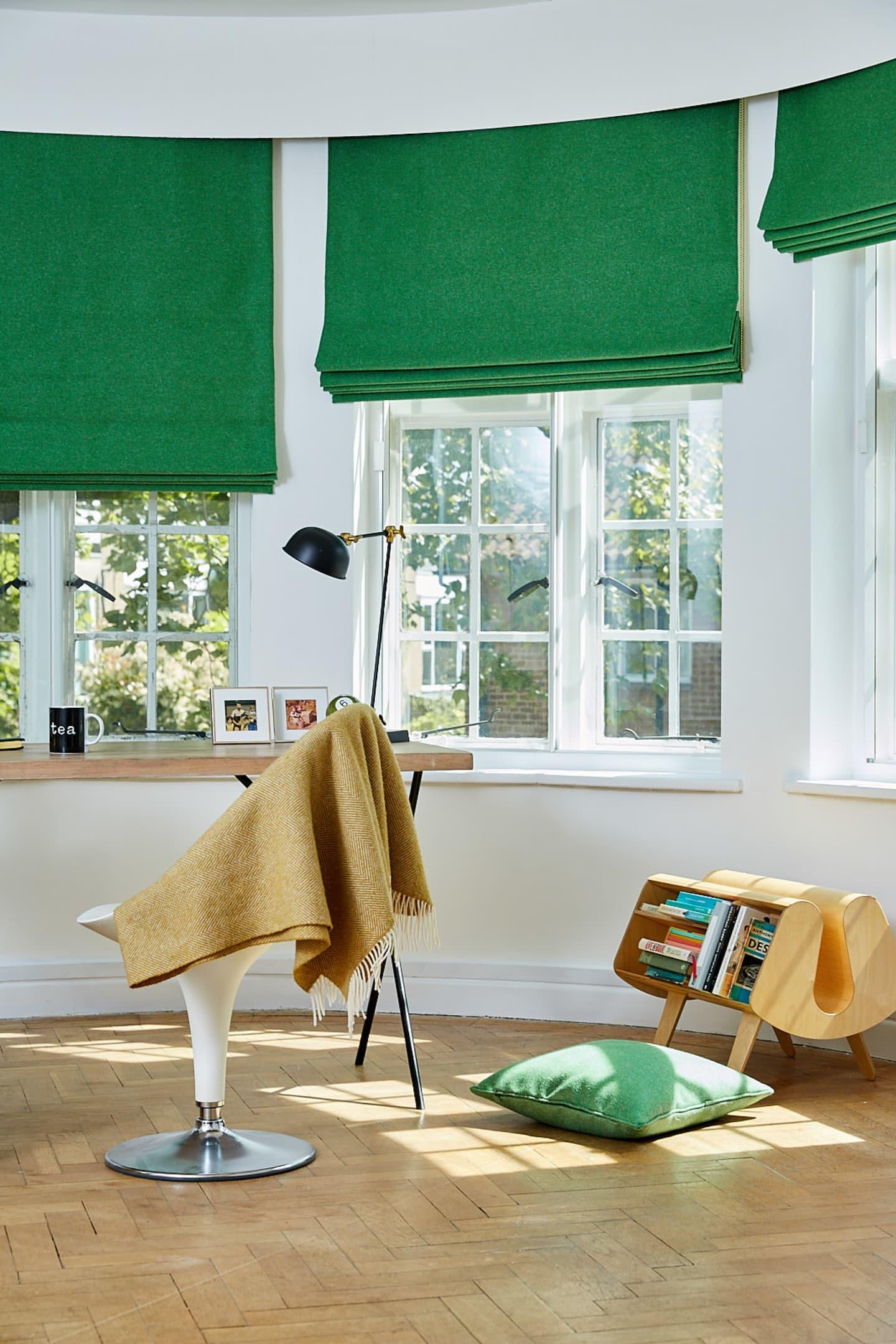 study desk facing windows and green wool roman blinds