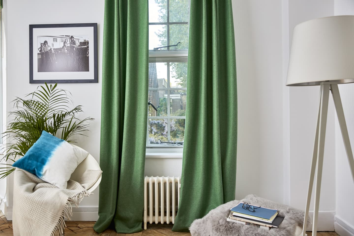 Green wool blinds in a white living room