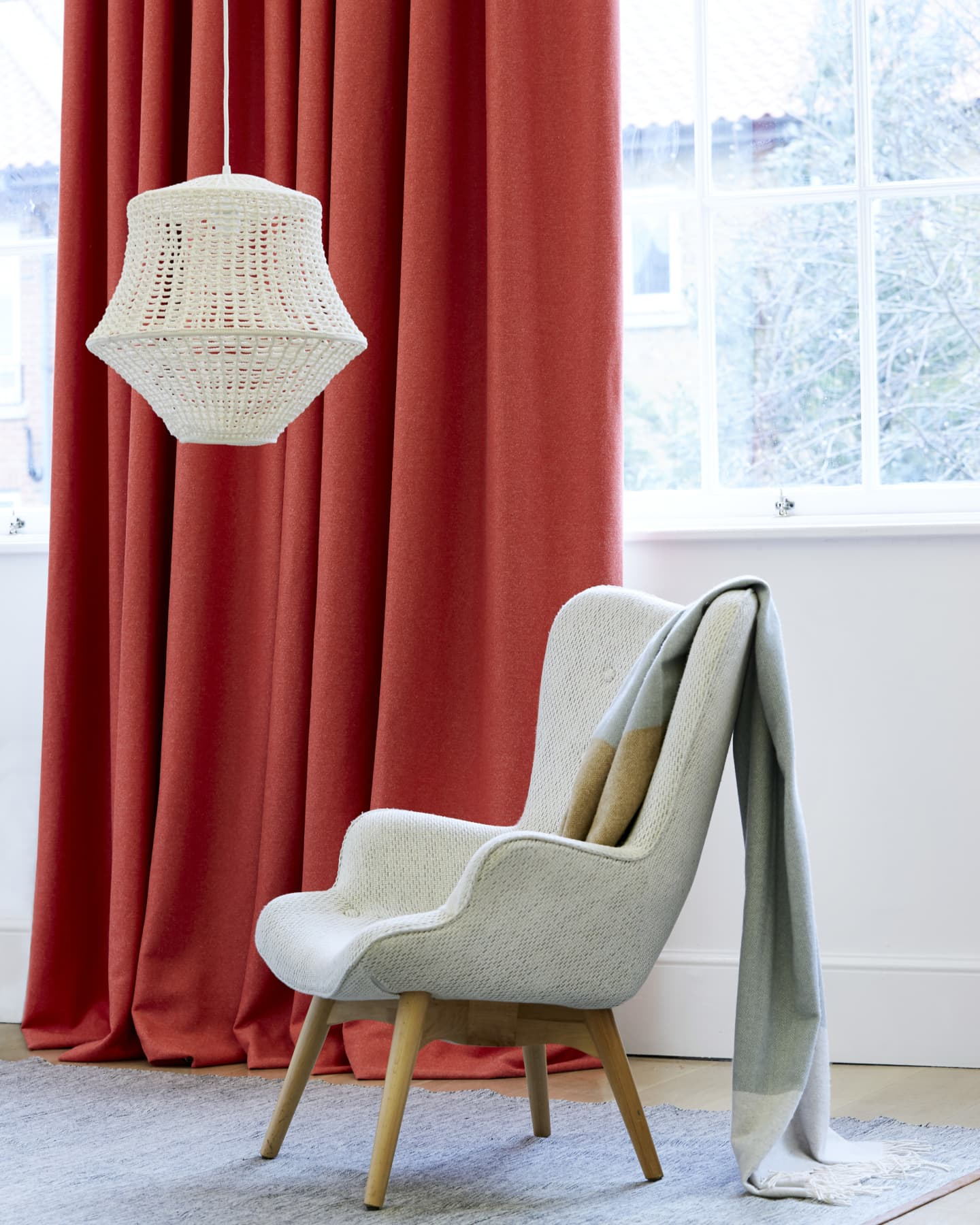 red silk curtain and textiles on a chair