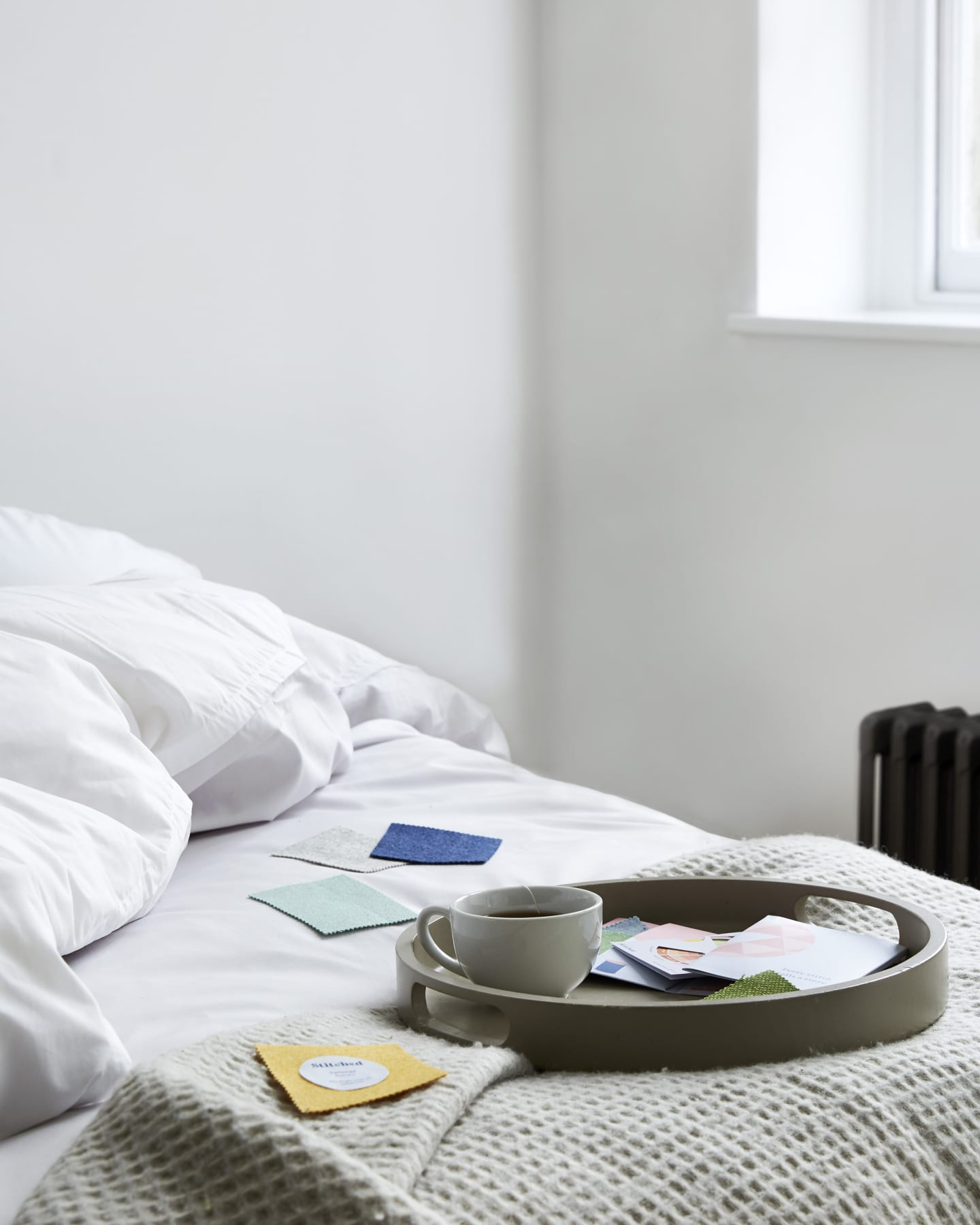 Close up of clean bed with a sample pack on top