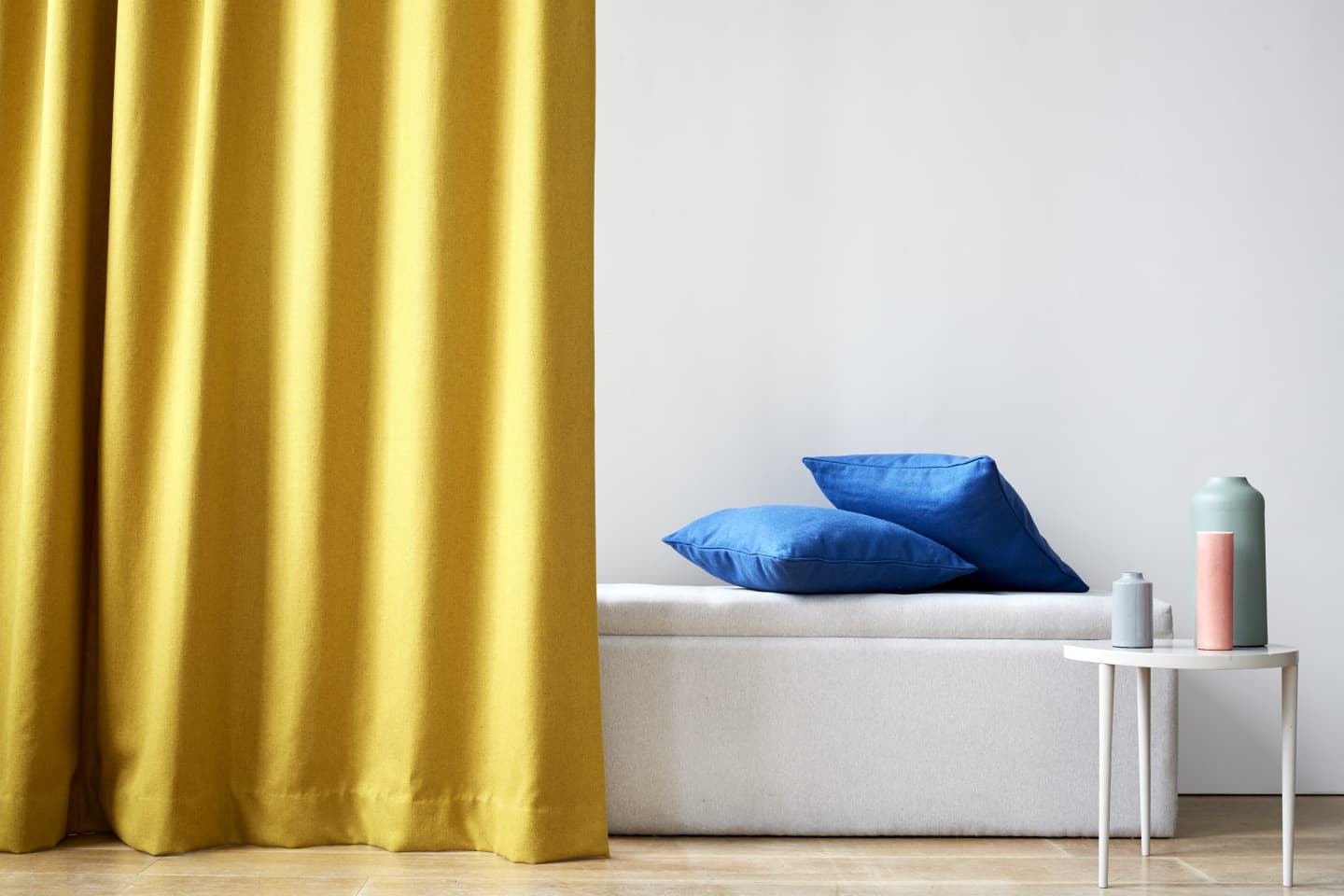 Yellow curtains and blue cushions