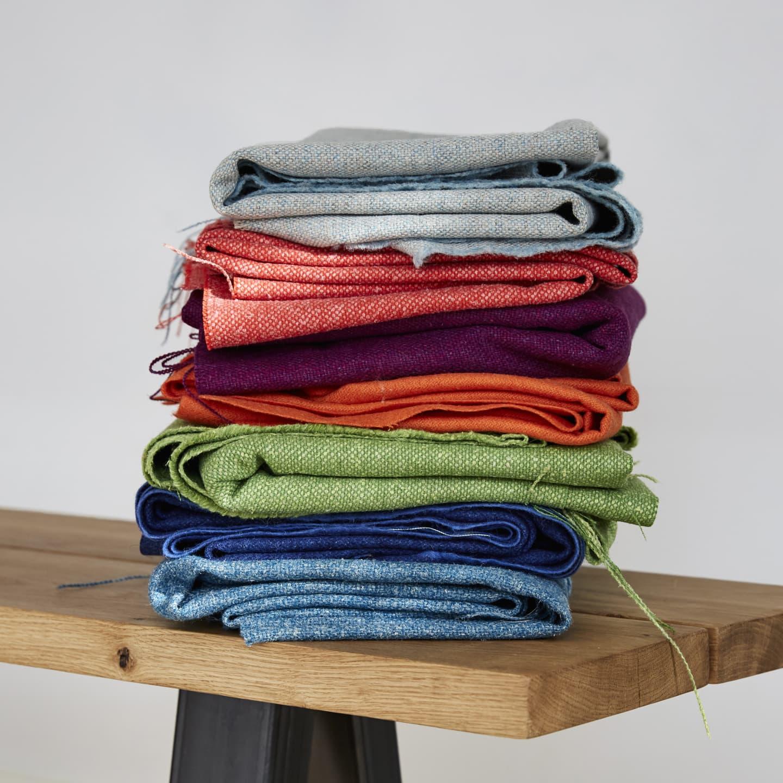 Multi coloured fabrics in a stack