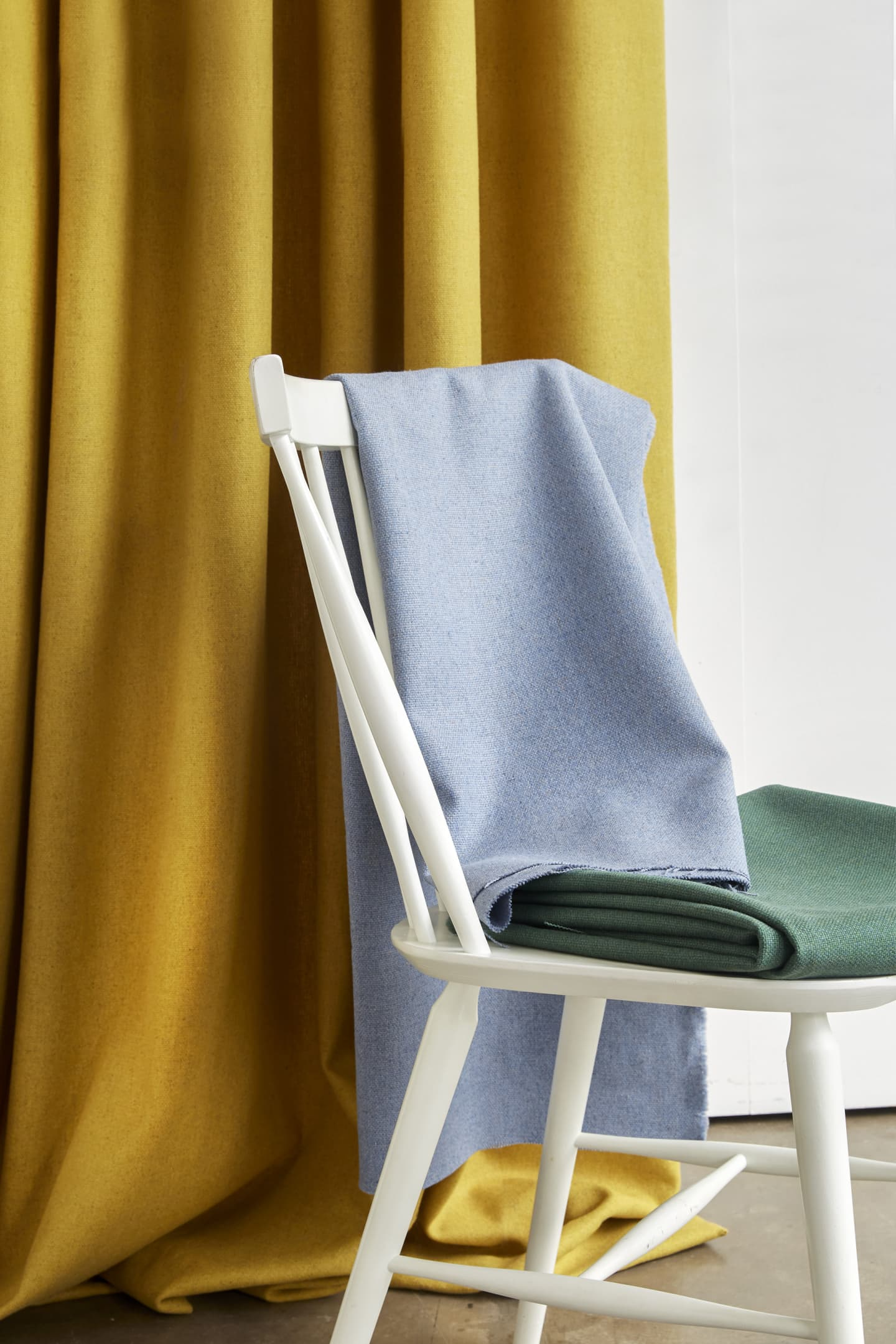 various curtains hung on chair