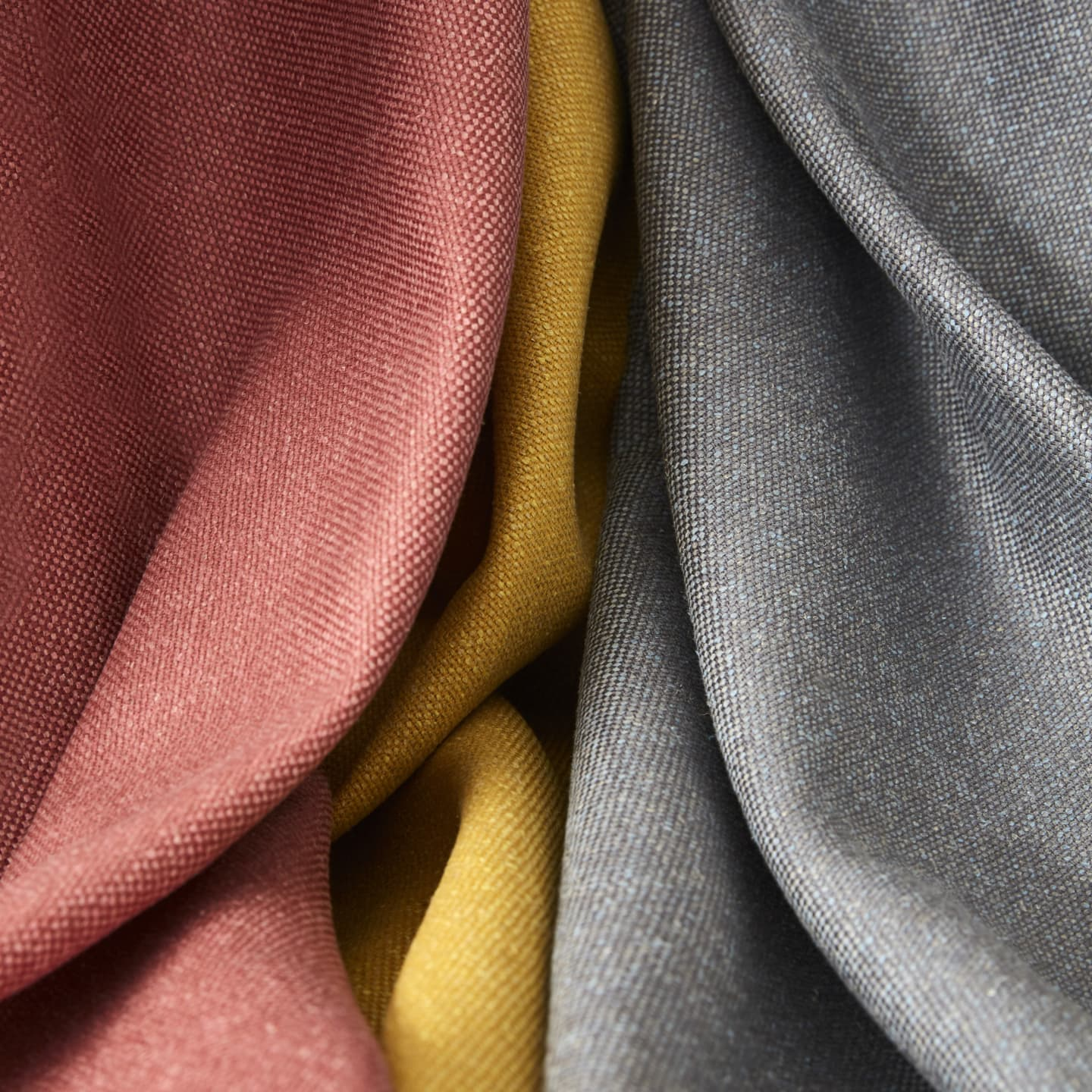Close up of red yellow and silver fabrics