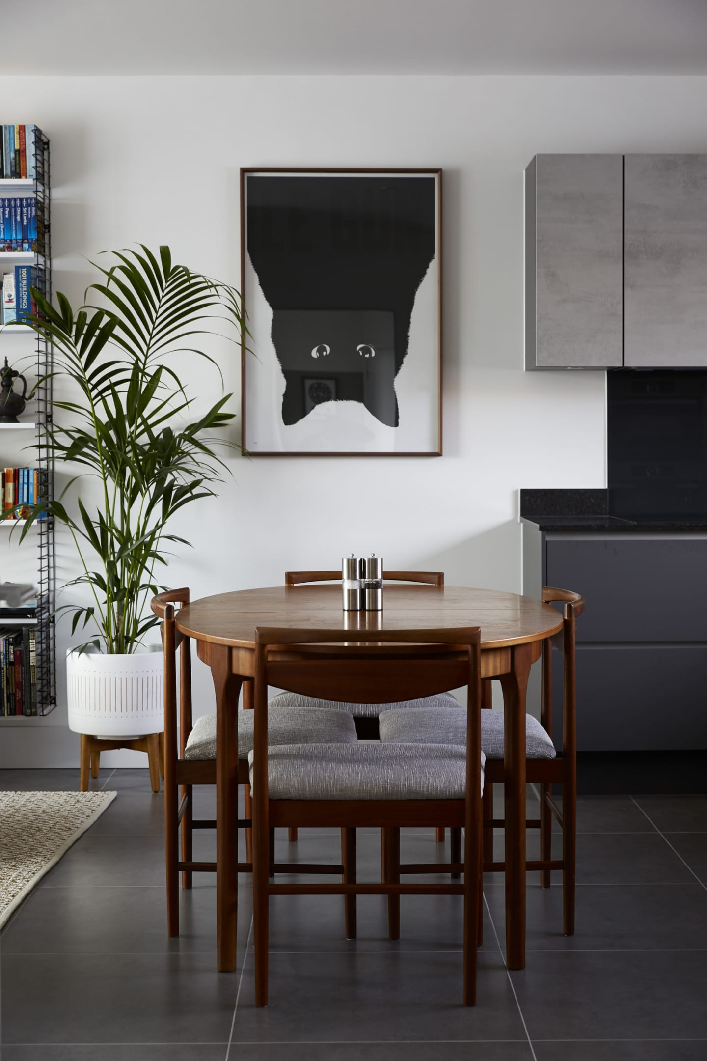 Sleek living room with large black cat print