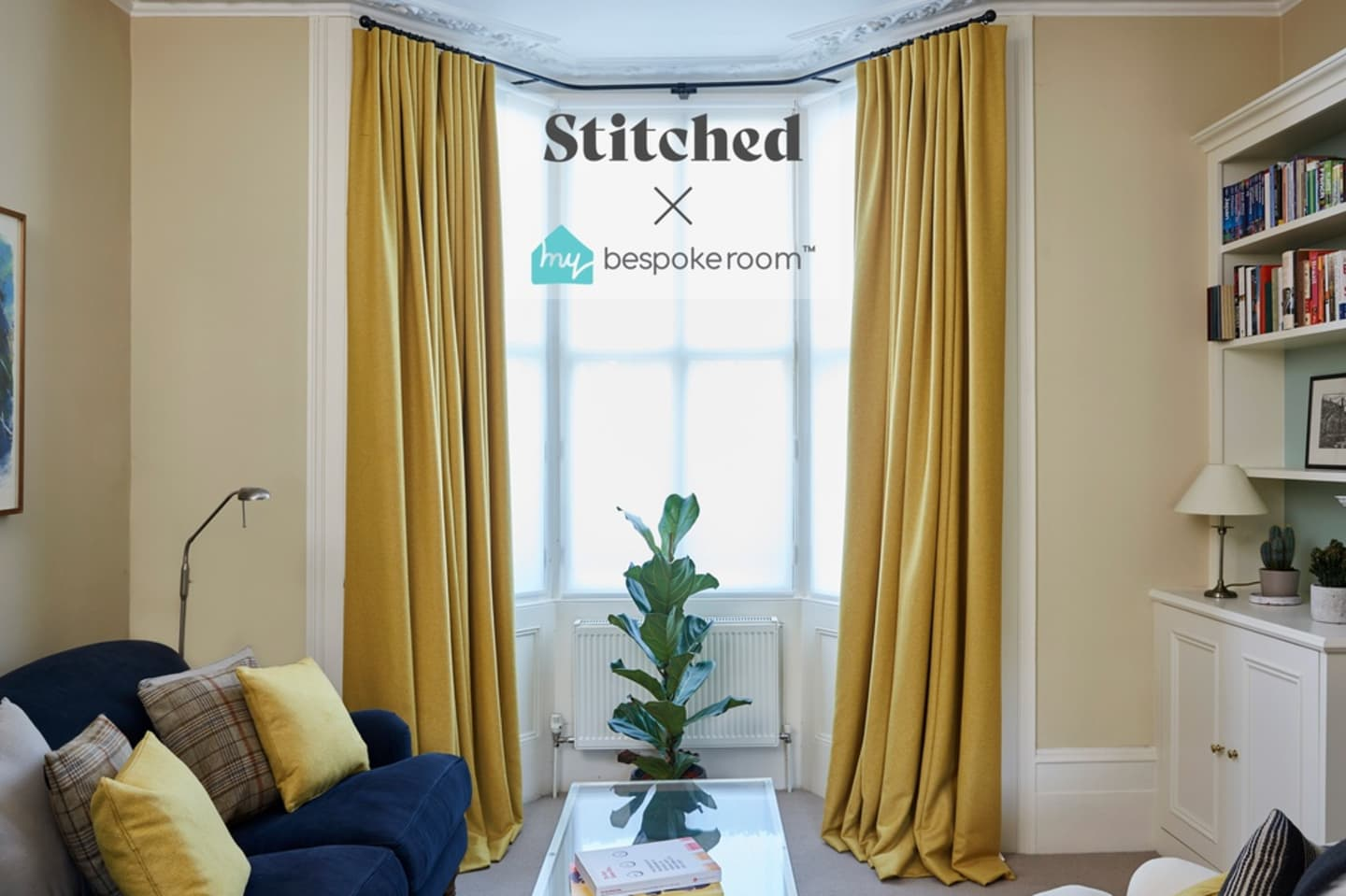 Bay windows with yellow curtains and green plant