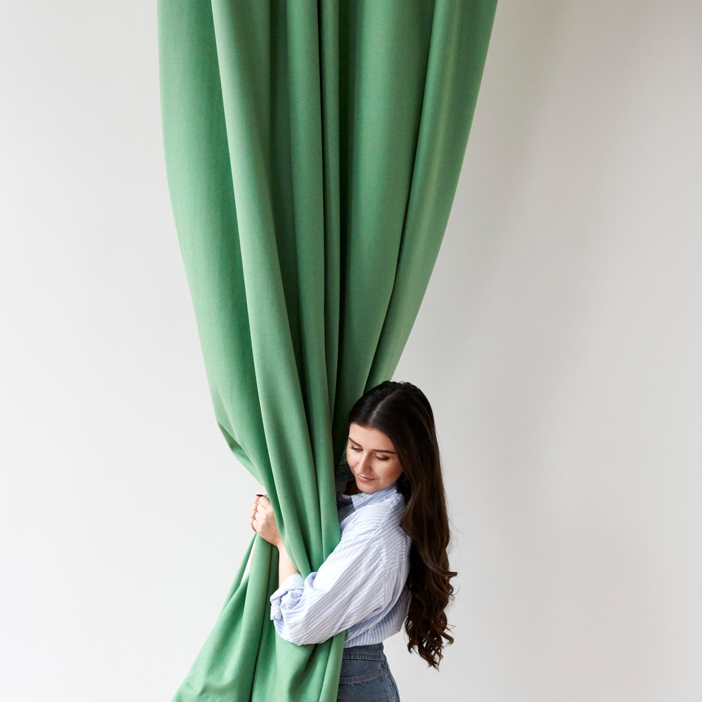 melissa hugging green curtain