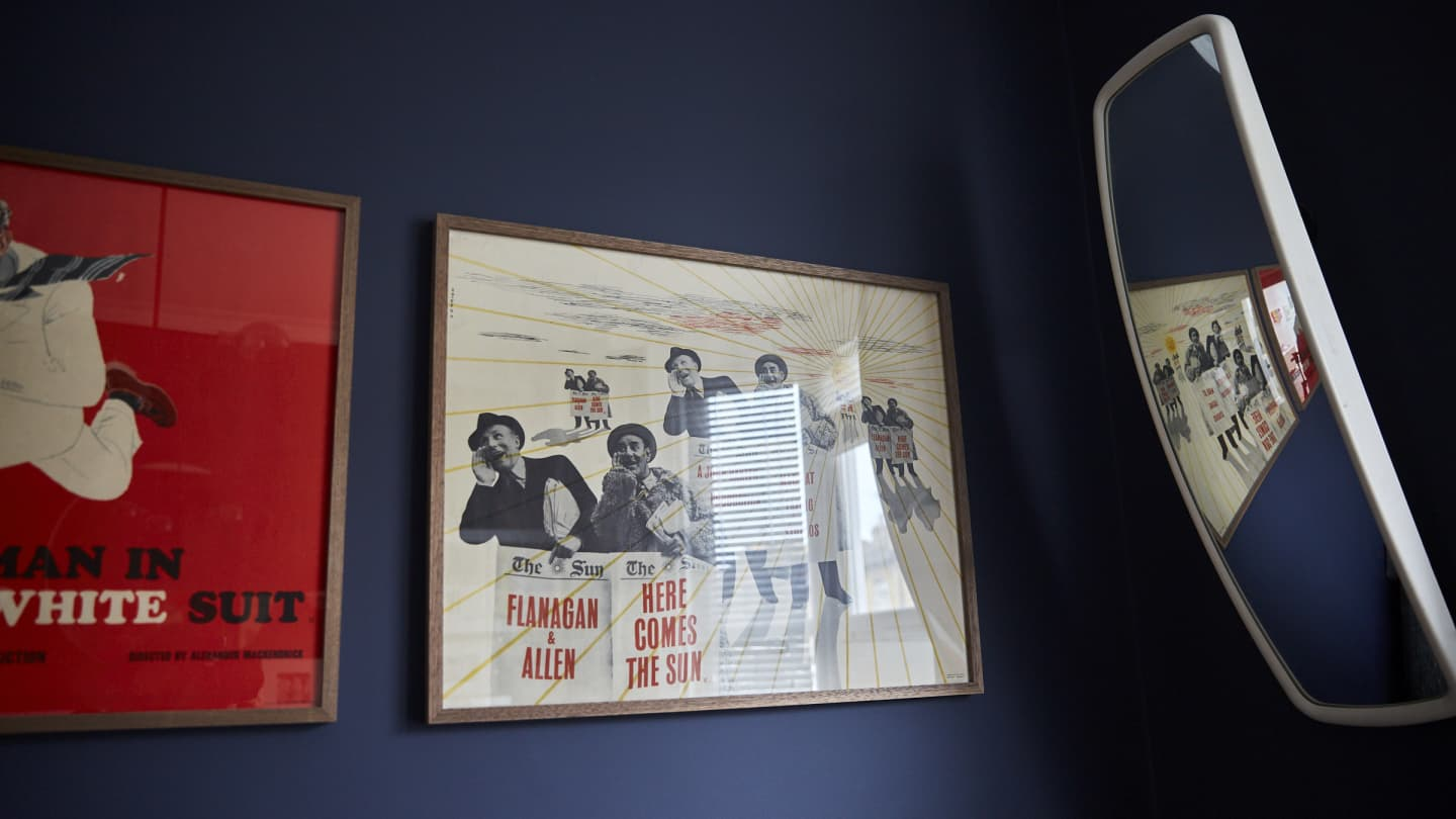 Framed screen prints on a wall