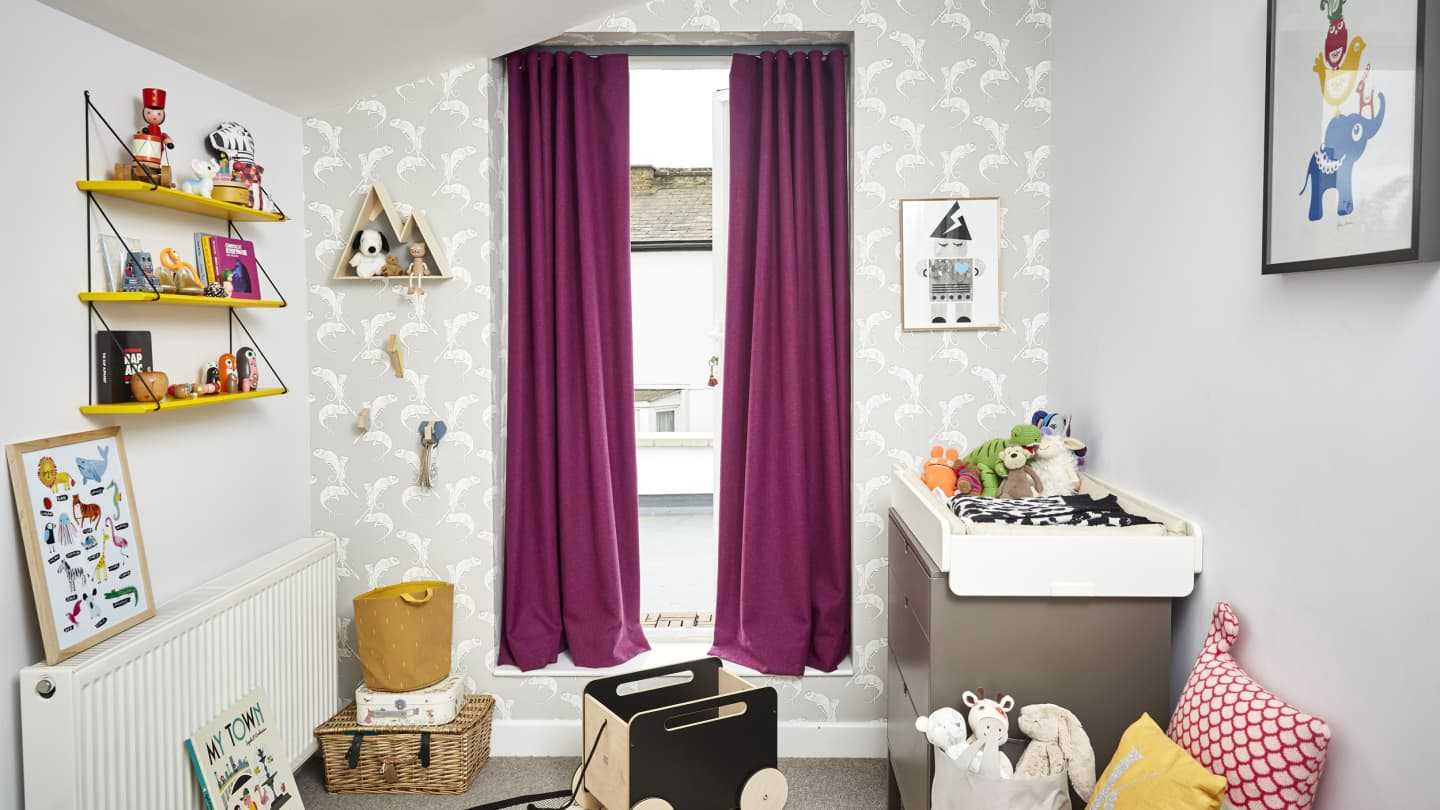 bright nursery with pink curtains