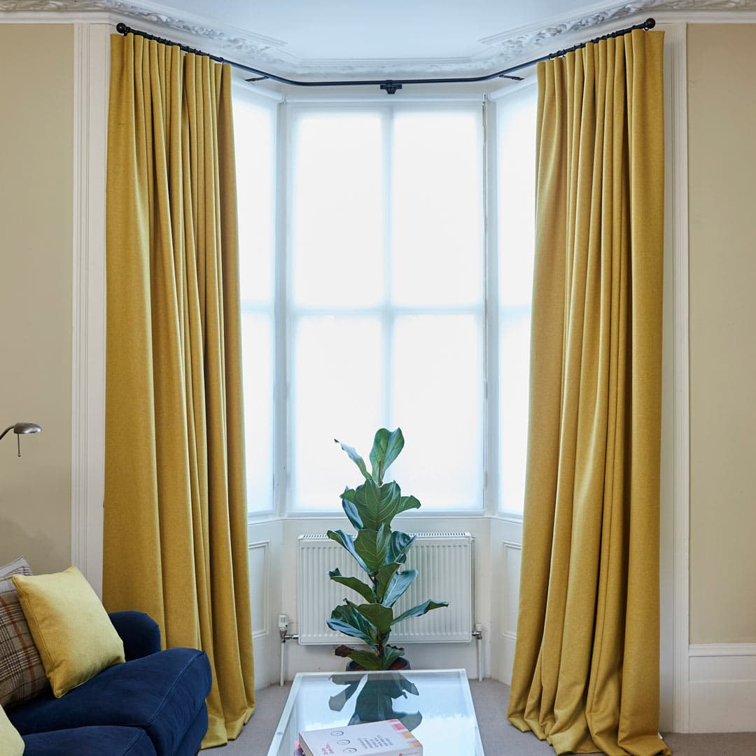 Living room with blue sofa and yellow curtains