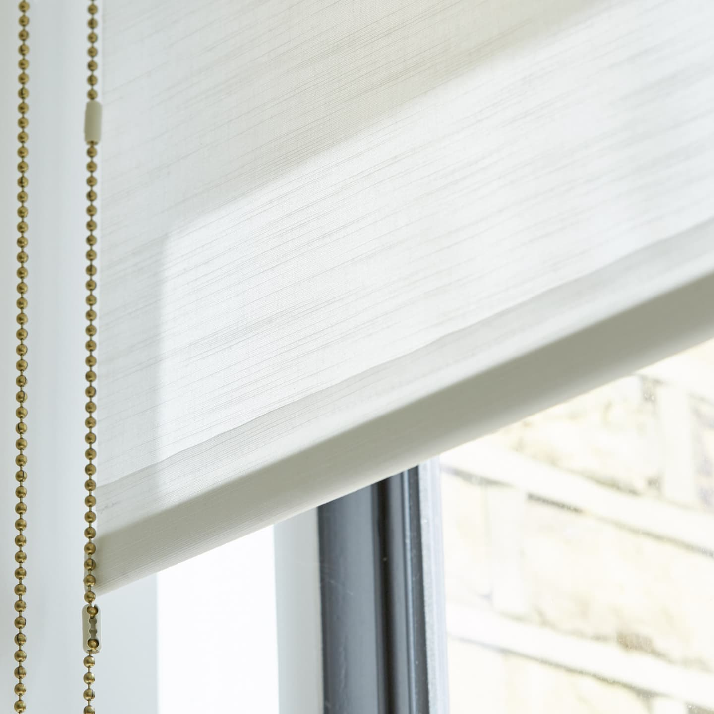 Close up of a white roller blind
