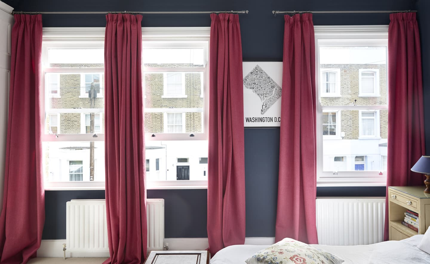 Open windows and three red/pink curtains