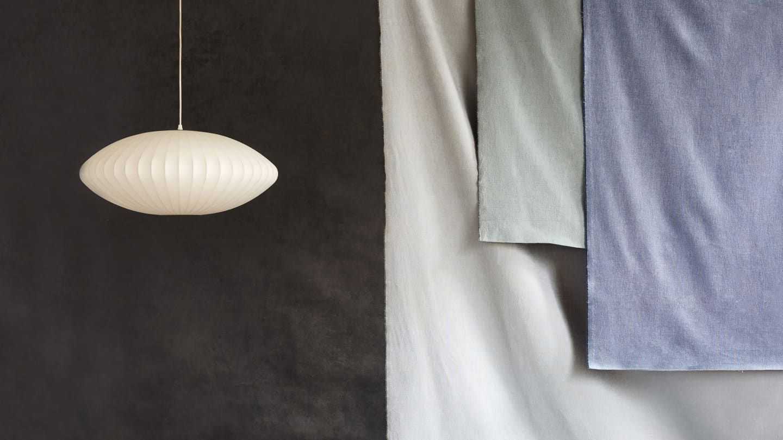 cream lampshade against dark fabric