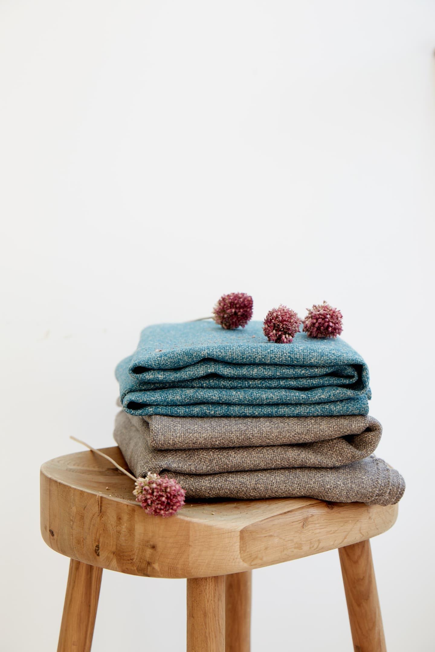 Pile of hemp fabrics with flower on top