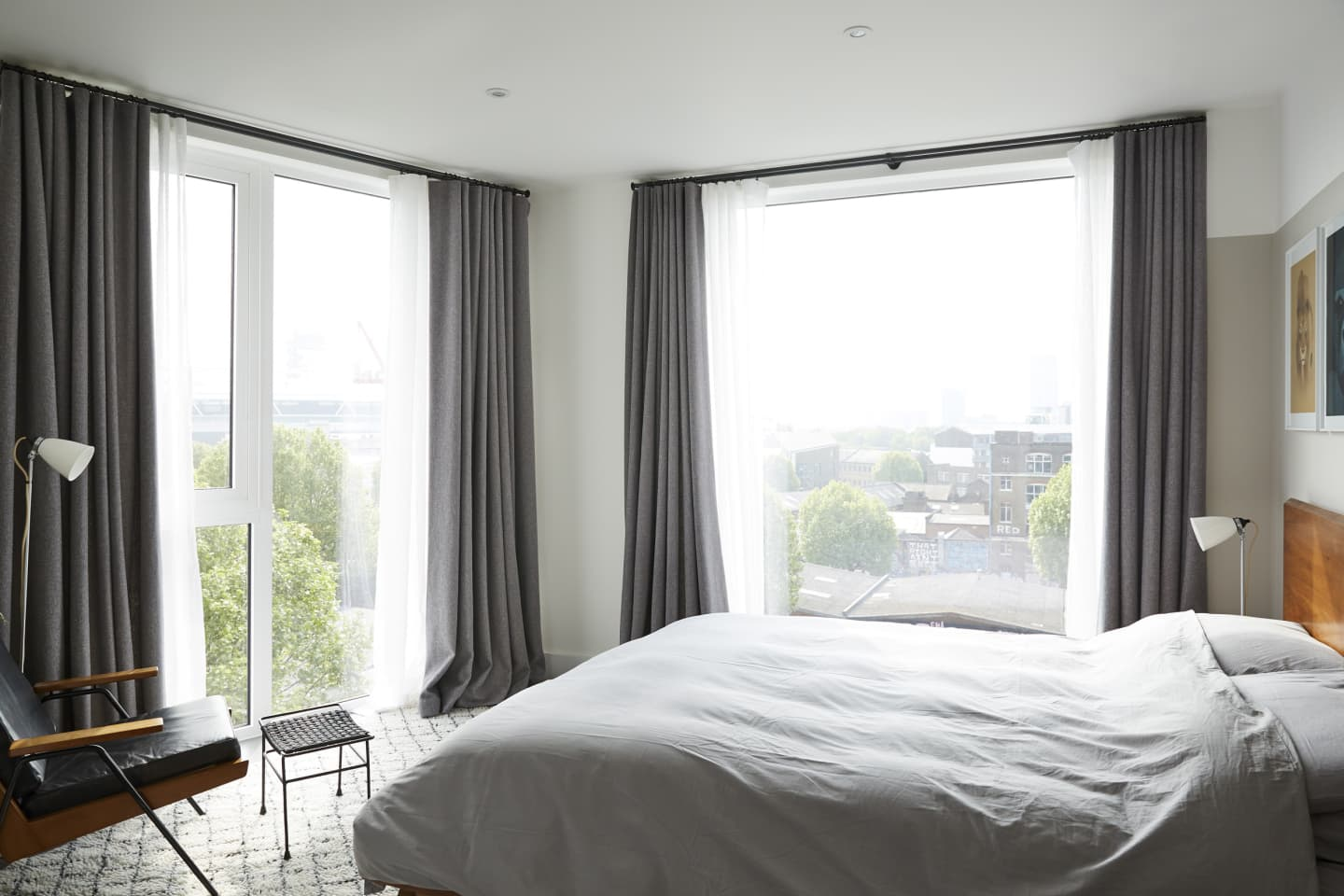 White bedroom interior with grey curtains